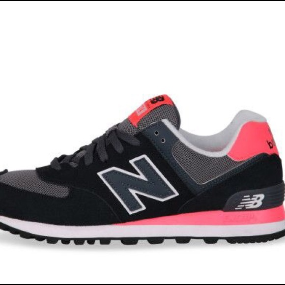 Pink and black New Balance 574 tennis shoes